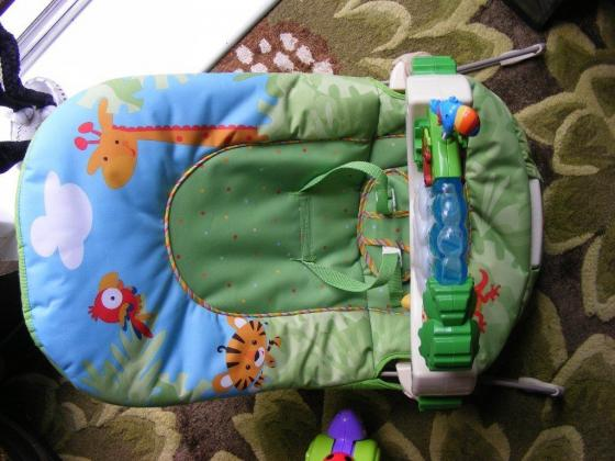 Door bouncer£5/fisher price rainforest floor gym/bounce and vibration chair.